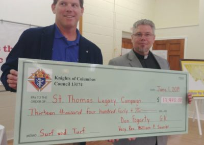 Don was able to present Father with a Check contributed from the Grand Knight of  $13,440.00 from the Raffle collections